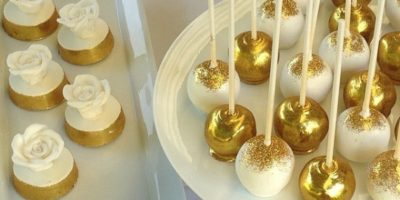 jewel-gold-and-white-birthday-dessert-table-pops-and-choc-coated-oreos-1